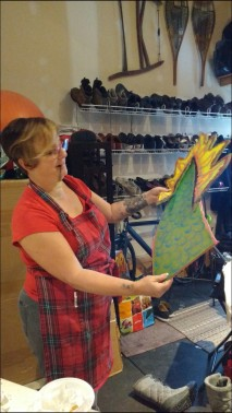 Tammy admiring our brand new Dragon Boat tail!